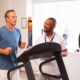 Physical therapist working with his patient during a treadmill session